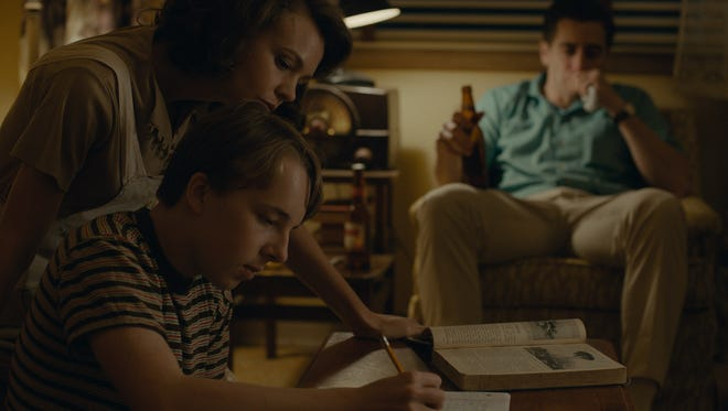 "Carey Mulligan, left, Ed Oxenbould and Jake Gyllenhaal in ""Wildlife."""