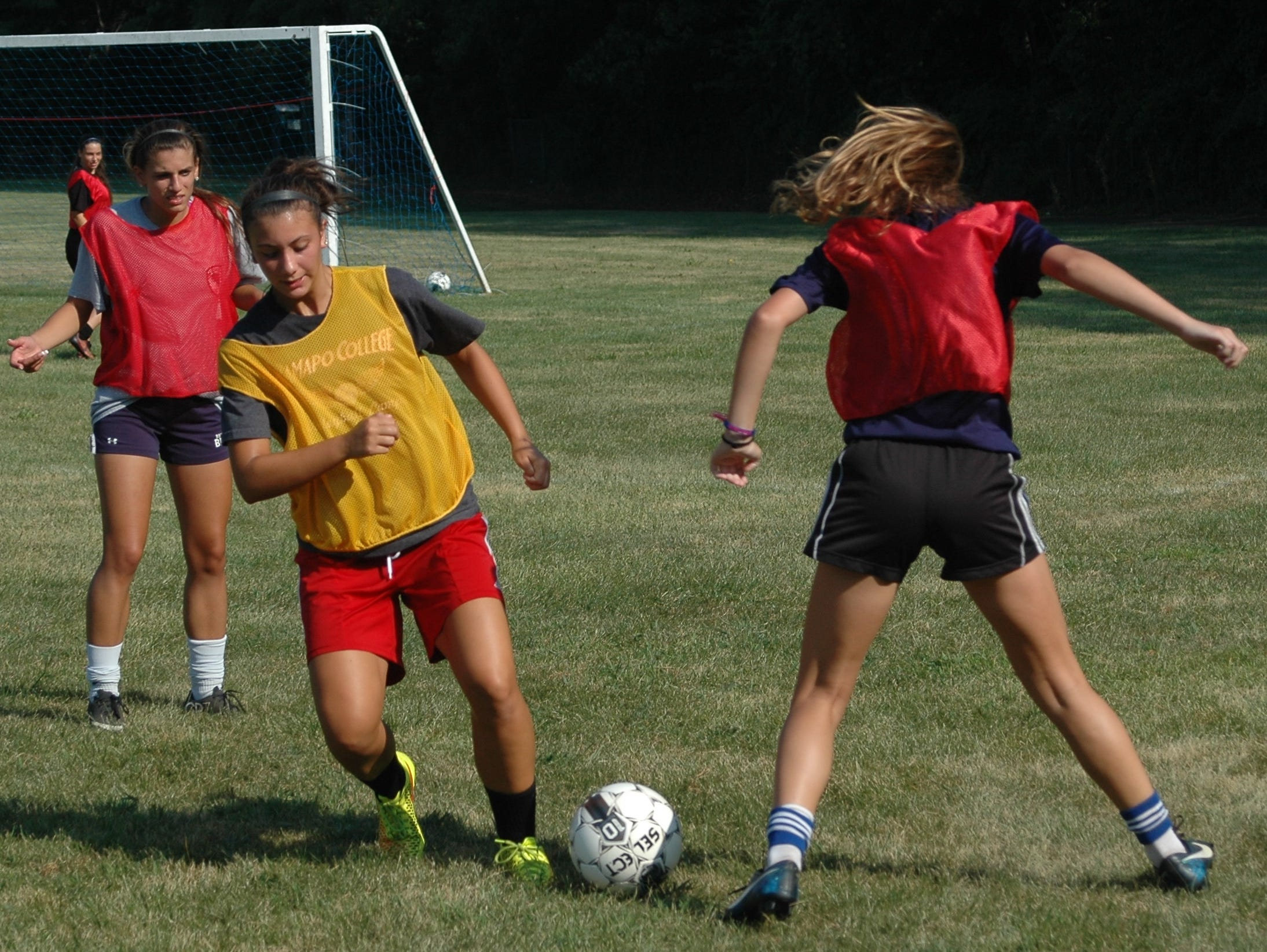Members of Clarkstown South's girls soccer team scrimmage during a pre-season practice session at Clarkstown South High School on August 25, 2015.