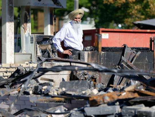 In August 2016 Pakhar Singh, the owner of the BP gas station at 3114 N. Sherman Blvd., looked over his business that was destroyed during civil unrest.
