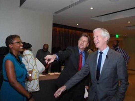 Phoenix Mayor Greg Stanton (center) jokes with The