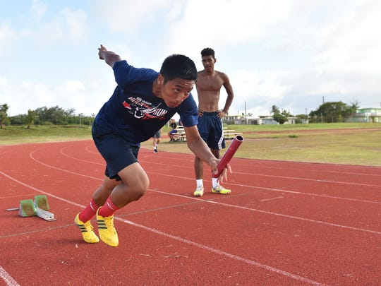 George Washington High School track and field team member Justin Sablan, 16, works on his 100-meter dash during a practice at the GW track in Mangilao on May 17, 2017.
