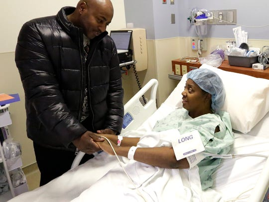 Verner Williams talks to his wife, Joyce, before she gets a kidney transplant at Froedtert Hospital in Milwaukee. February 10, 2016.