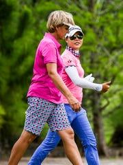Barb Mucha of Orlando, Florida, walks with Sue Kim, Langley, British Columbia, on hole 18.  2016 Chico's Patty Berg Memorial Round 3 Saturday, April 16, 2016 at Cypress Lake Country Club.