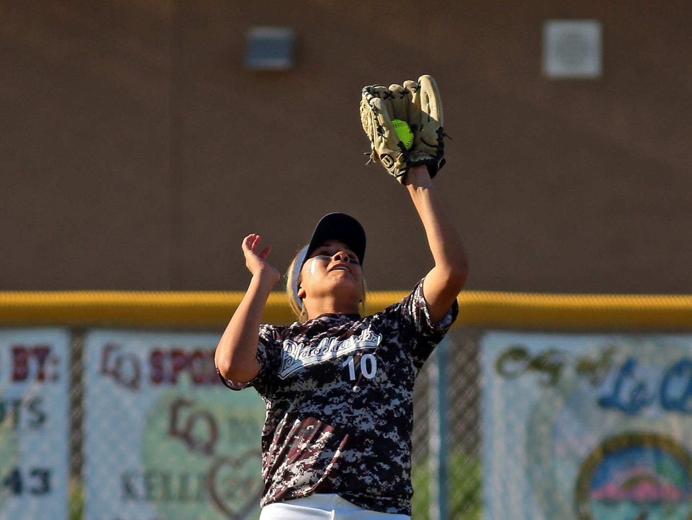 La Quinta's Mia Olvera (10) catches a ball hit by Shadow Hills during the first game of a double header on Thursday afternoon, March 26, 2015 at La Quinta. La Quinta won the first game 7-5 and the second game 4-1.