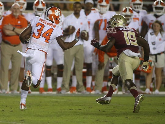 A.J. Westbrook (19) chases Ray-Ray McCloud (34) during