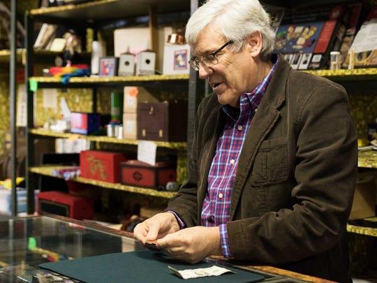 Greg Bordner, president of Abbott's Magic Co., preforms a Scotch & Soda trick in his shop.