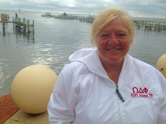 """Sherry Sharlow, a retired teacher from Massena, New York, watched her first launch from the shoreline of Space View Park. After the launch, she said: """"I can't think of a nicer place to see a launch."""""""