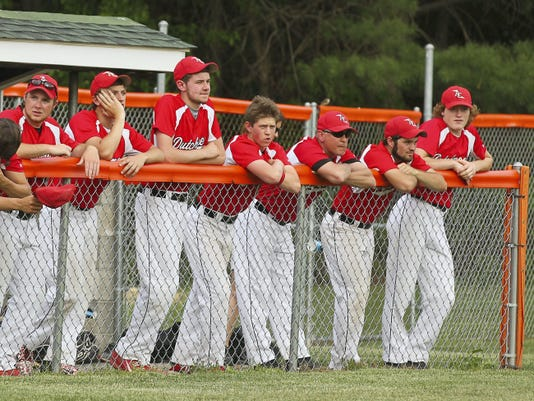 Annville-Cleona players watch play during the second inning of their 4-3 loss to Upper Dauphin.