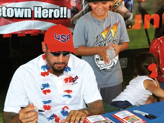 Jaime Guzman--For the Sun-News   Tony Mancha takes time to sign some autographs for local fans at a welcome home reception given to him by family and friends. Mancha returned to Las Cruces on Sunday after playing for the United States men's sofbtall team in the 2015 Pan American Games in Toronto.