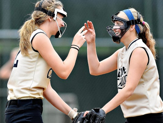 Delone Catholic players celebrate during the Squirettes' PIAA Class AA first-round state softball game vs. Philadelphia Academy Charter School on Wednesday at York College. Delone won the game, 6-0.