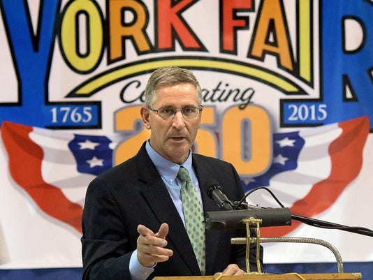 Pennsylvania Secretary of Agriculture Russell Redding speaks during the opening ceremony for the York Fair Thursday at Utz Arena. The anniversary year ceremony included a 1765 ceremonial transfer of charter and a performance by the Central Middle School Fife and Drum Corps.