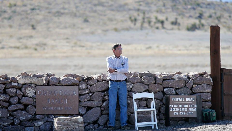A man guards the entrance to Cibolo Creek Ranch in