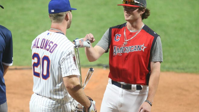 Blaze Jordan, right, who was drafted in the third round by the Red Sox, is congratulated by the Mets' Pete Alonso after winning last year's High School Home Run Derby in Cleveland.