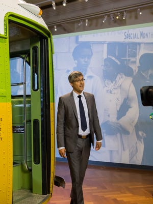 Mo Rocca prepares to climb aboard the Rosa Parks bus at the Henry Ford in Dearborn.