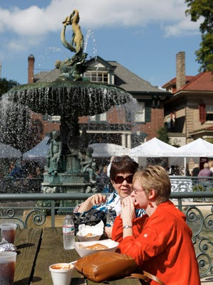 Leann Lawrence, left, and Kelly Brown had lunch at the St. James Court Art Fair. (By Bill Luster, The Courier-Journal) October 2, 2009