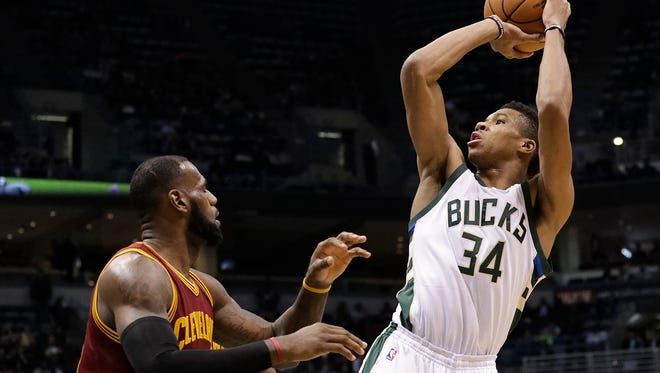 The Milwaukee Bucks' Giannis Antetokounmpo shoots over the Cleveland Cavaliers' LeBron James during the second half of an NBA basketball game Tuesday, Nov. 29, 2016, in Milwaukee.