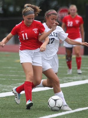 Somers' Ella Beresford, left, fights for the ball with Eastchester's Katie Bugbee during their game at Eastchester Sept. 6, 2016. Somers won 8-1.