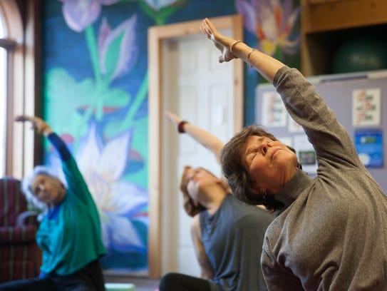 Meg Tipper of Burlington attends a yoga class Monday