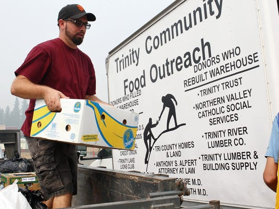 James Norman unloaded donated goods from the Hayfork