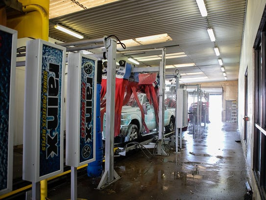 A truck is washed at All American Super Car Wash in