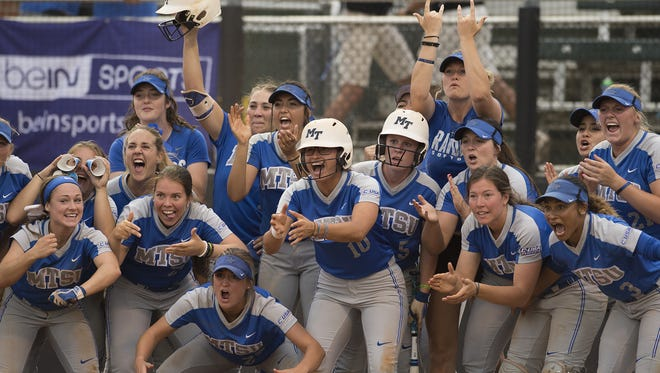 The MTSU softball team celebrates during their 11-6 win over UAB in the Conference USA tournament on May 10, 2018 in Charlotte, N.C.