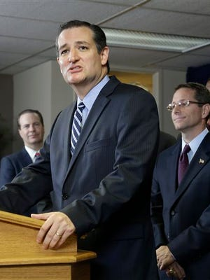 U.S. Sen. Ted Cruz (R-Texas) is surrounded by preachers as he addresses a crowd at a Houston church, Thursday. Cruz spoke about a legal dispute involving several pastors fighting subpoenas from Houston city attorneys demanding they turn over copies of any sermons they delivered that relate to Houston's equal rights ordinance championed by the city's gay mayor, Annise Parker.