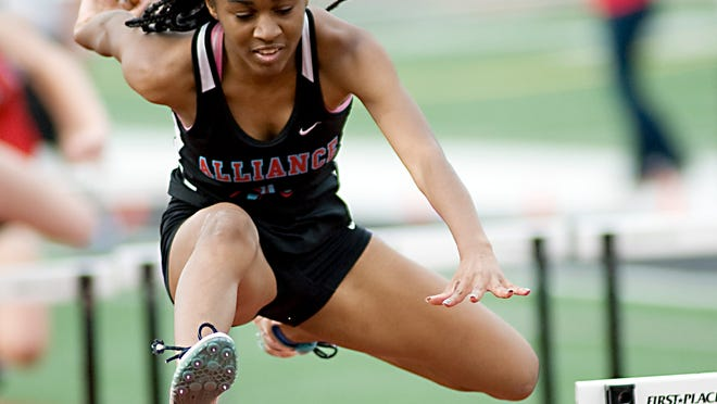 Alliance's Zarliyah Board-Gurly clears the standard in the girls 100 meter hurdles during the Division II district track and field meet in May 2019.