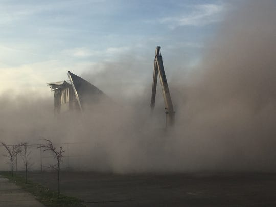 A cloud of dust rises over the remains of the old Immanuel