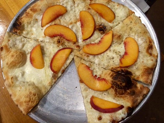 The seasonal peach pizza at City House