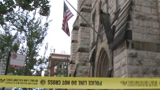 A photo taken from a video shows a church, where a Chicago woman was killed, behind a police line.