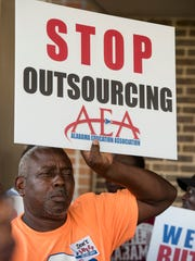 Custodians protest outside of the Montgomery County School Board meeting in Montgomery, Ala. on Tuesday August 22, 2017.