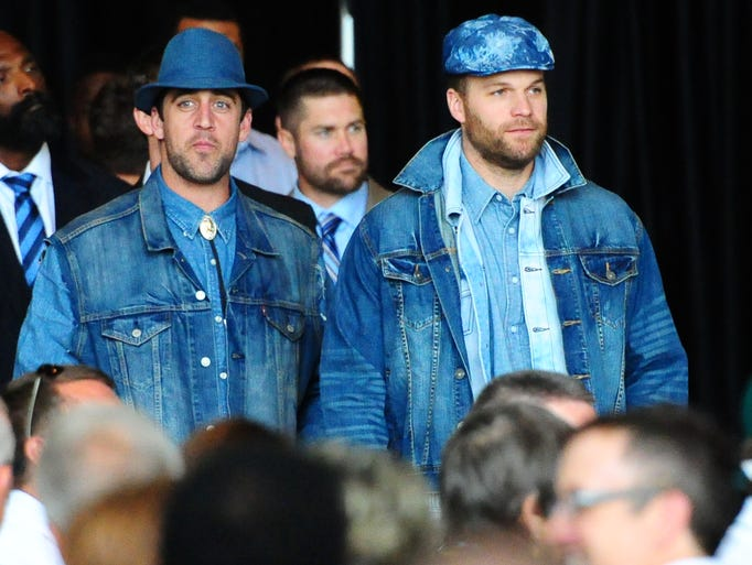 Green Bay Packers quarterbacks Aaron Rodgers, left, and Matt Flynn wear denim to the 51st annual Welcome Back Packers Luncheon at the Lambeau Field Atrium, Wednesday, August 27, 2014.