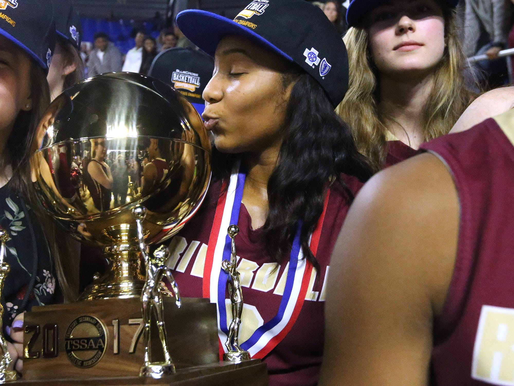 Riverdale's Anastasia Hayes (3) kisses the Championship Trophy after Riverdale's victory over Memphis Central in the Class AAA State Tournament on Saturday, March 11, 2017.