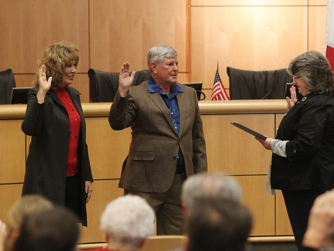 Mary Rickert, from left, and Steve Morgan are sworn