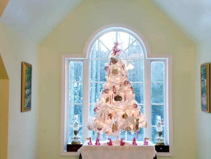 A white and pink Christmas tree that was purchased