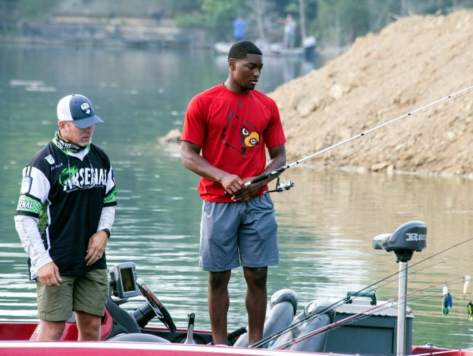 Louisville football players fish with wounded warriors for King fish louisville