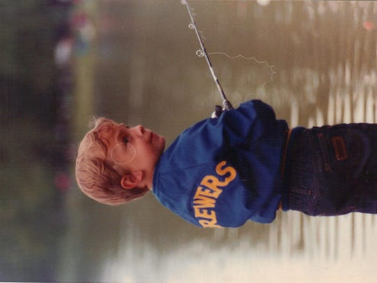 Nick Nault fishing during the early years of the Father's Day Kids Fishing Day at Little Lake in Sturgeon Bay.