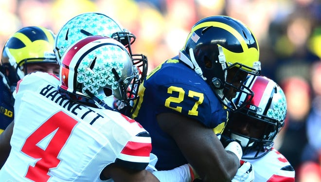 Derrick Green runs against Ohio State in 2013 at Michigan Stadium.