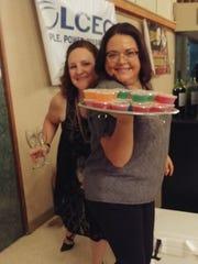 Dusty Shelton and Sarah Sheffield serve gelatin shooters