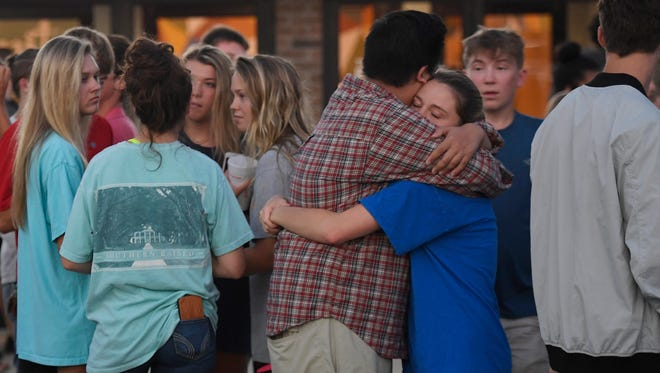 Community members attend a vigil Saturday night at Experience Community Church in Murfreesboro for Blackman High School students involved in an early-morning car crash.
