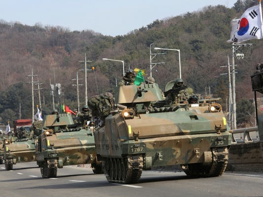 """South Korean army's armored vehicles move during a military exercise in Paju, South Korea, near the border with North Korea, Wednesday, Feb. 7, 2018. Vice President Mike Pence said the U.S. is preparing to announce the """"toughest and most aggressive"""" economic sanctions against North Korea in the coming days, boosting pressure on the bellicose government during the Winter Olympics. (AP Photo/Ahn Young-joon)"""