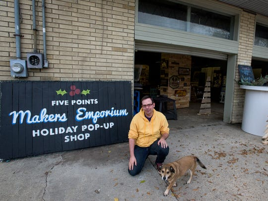 Joe Birdwell and Cora are maning the Makers Emporium Holiday Pop-Up Shop at Five Points in Montgomery, Ala. on Thursday December 10, 2015. Local artists show and sell their work at the pop-up.