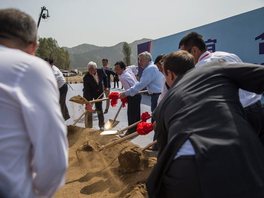 Rick Kimberley, farmer from Maxwell, Iowa, Qu Dongyu, China's Vice Minister of Agriculture and Terry Branstad, US Ambassador to China, break ground for the China-US Demonstration Farm on Saturday, Sept. 23, 2017, in Luanping County, Hebei, China. The farm in China will be modeled after Kimberley's farm in Iowa.