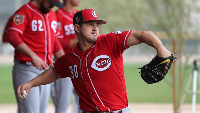 Cincinnati Reds pitcher Tyler Mahle (30) throws in the bullpen, Wednesday, Feb. 14, 2018, at the Cincinnati Reds Spring Training facility in Goodyear, Arizona.