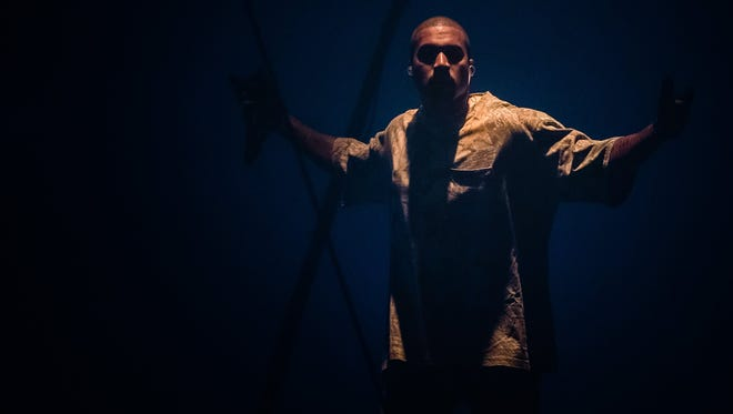 Rapper Kanye West sings to the crowd at Joe Louis Arena in Detroit during a stop on his nationwide Saint Pablo tour, on Sep 28, 2016.