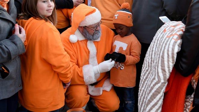 Demetrius Downer, cousin of Tennessee Rashaan Gaulden, is greeted by Vol Santa during the Vol Walk at Vanderbilt Stadium on Saturday, Nov. 26, 2016.