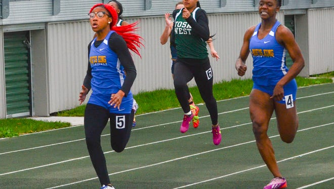 Amari Brown takes the lead in the girls 100 meters at the Dan Benson Invitational on Friday.
