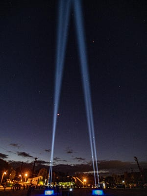 Twin towers of light stream to the heavens at the conclusion at a 9/11 memorial ceremony at Franklin Pond Friday, Sept. 11, 2020. [Photo by Warren Westura/for the New Jersey Herald