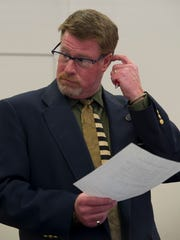 Vermont Liquor Control Director of Enforcement, William Goggins, listens to Vermont Assistant Attorney General, Jacob Humbert, during a Liquor Control hearing held at the departmentsâ?? offices in Montpelier, Wednesday, April 1, 2015.