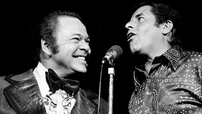 """Roy Clark, left, and Jerry Lewis are performing together for a few laughs during the """"Lewis and Clark Entertainment Expedition"""" for the benefit of muscular dystrophy patients at the near capacity Municipal Auditorium on June 24, 1975."""